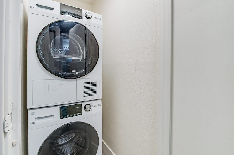 washer and dryer units in a Peaks on Drake apartment