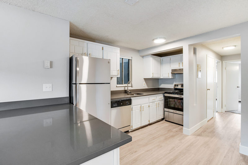 kitchen, countertops, and stove at the Peaks on Drake apartments