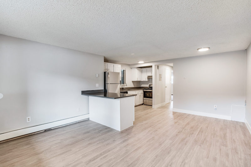 view of living room into kitchen - Peaks on Drake apartments in Fort Collins